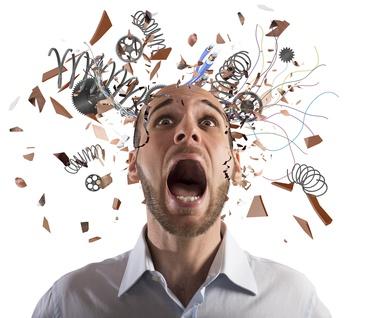 Stressed businessman with broken mechanism head screams